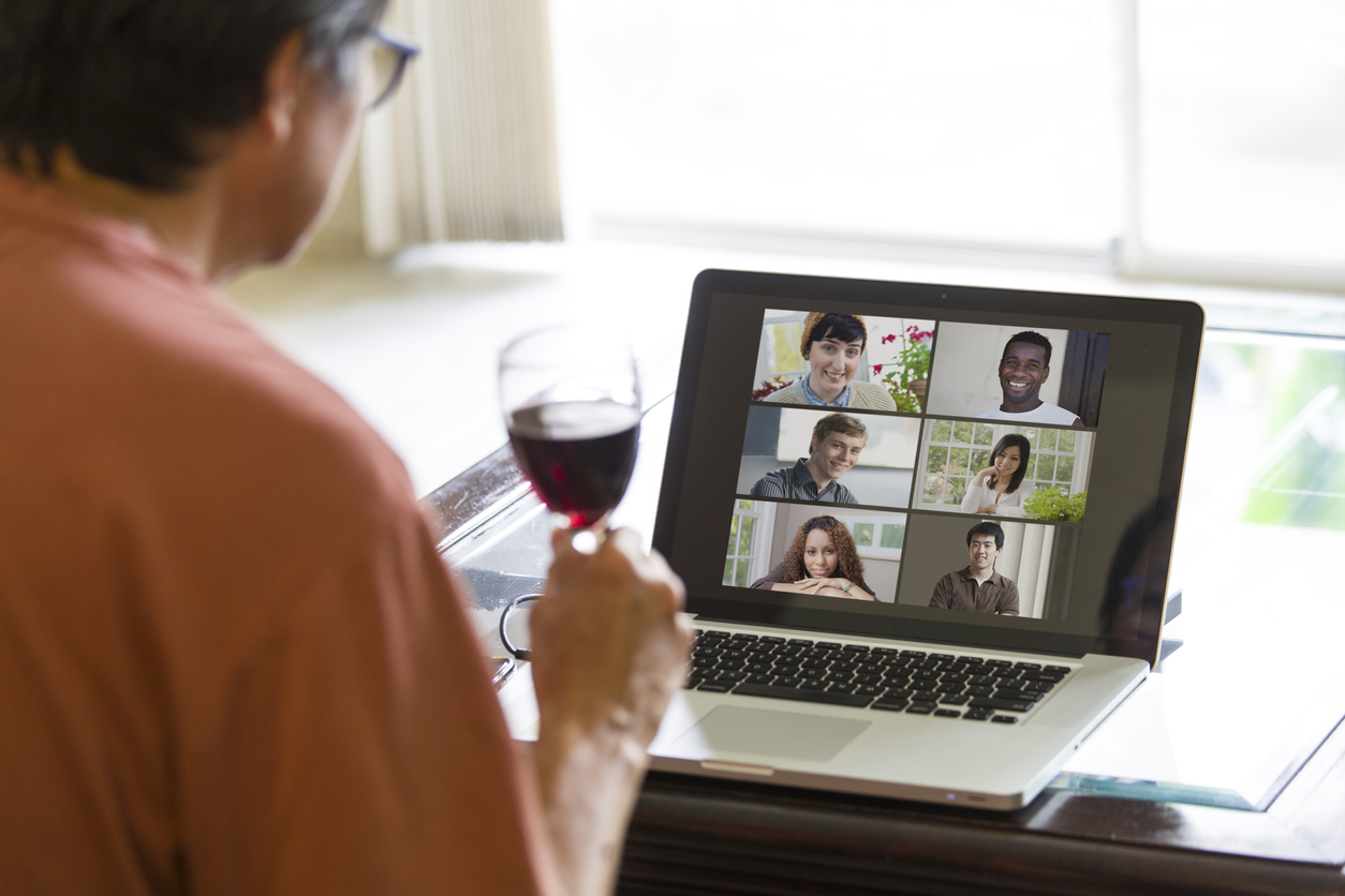 A man participating in a virtual happy hour.