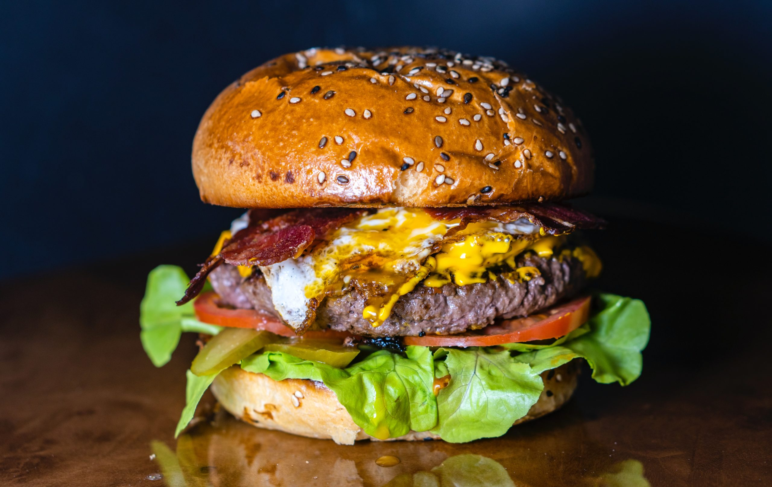 A burger with all the toppings.