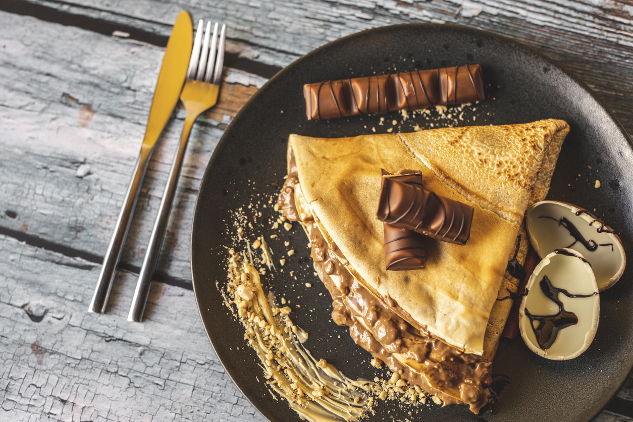 a plate with a sweet crepe
