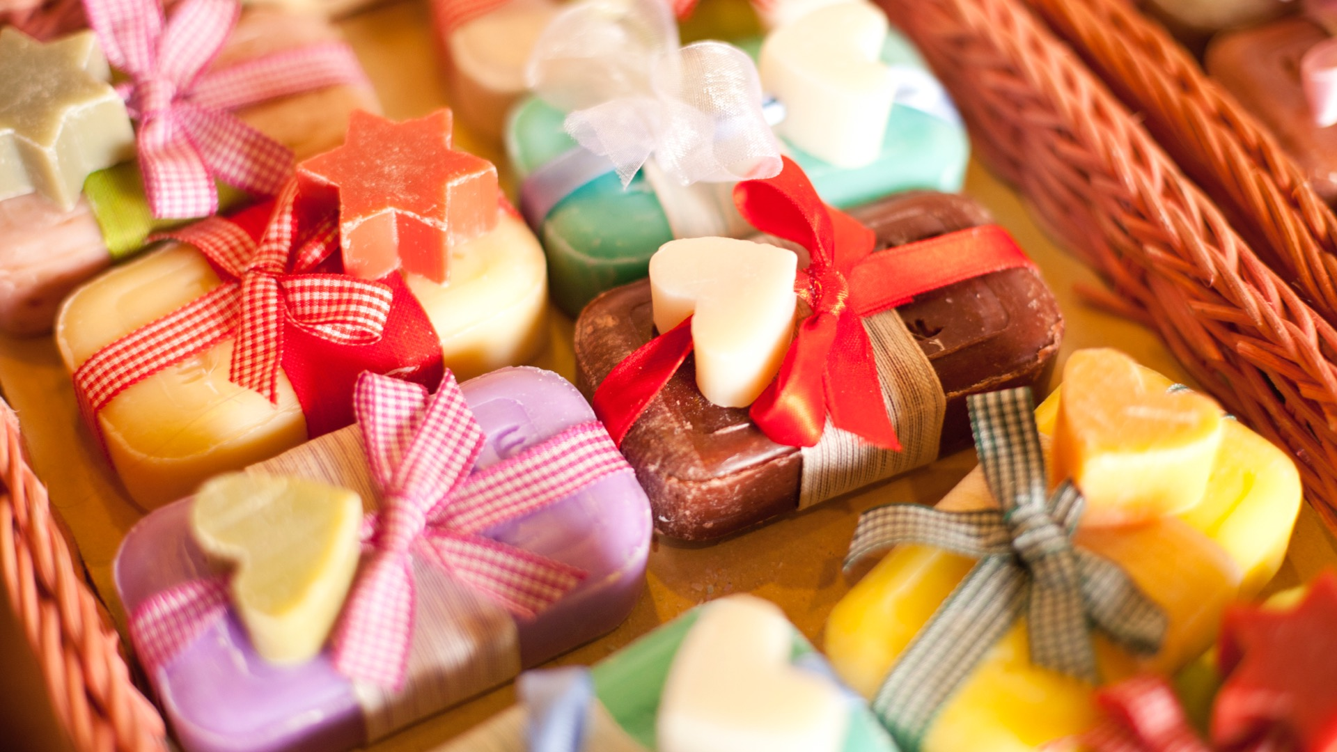 an assortment of handmade soaps on display.