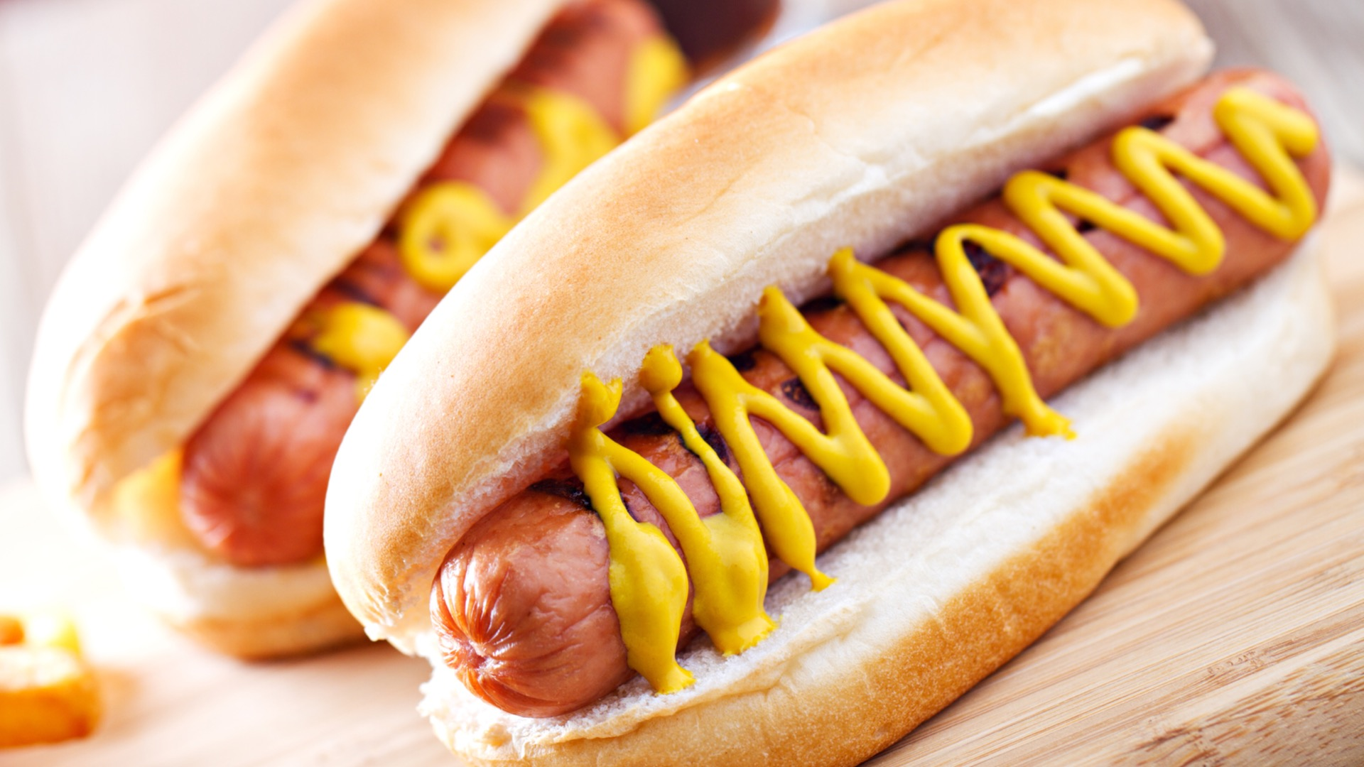 A hot dog with mustard - best hot dogs in Baltimore