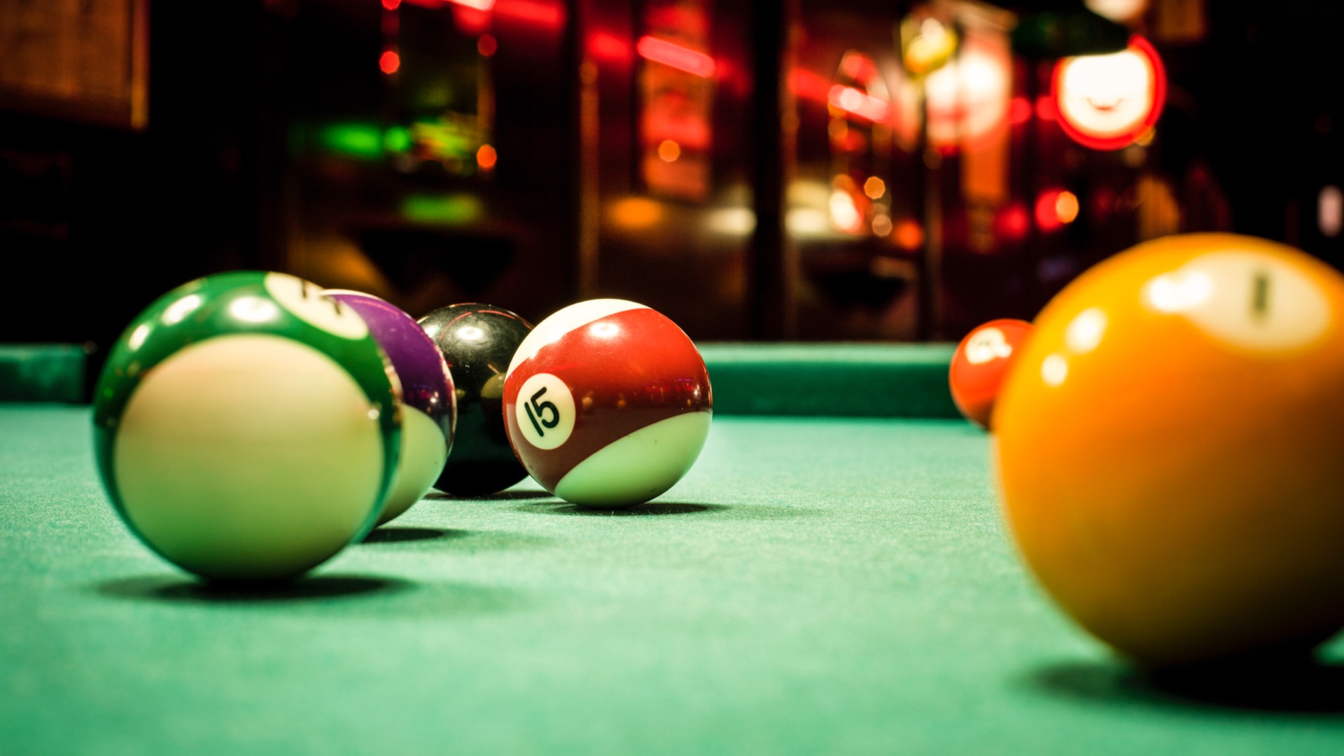 A billiards table with balls | Baltimore's best gaming bars